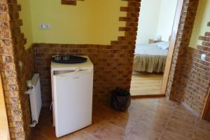 A kitchen or kitchenette at Diana Guest House