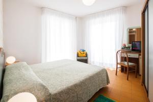 Postel nebo postele na pokoji v ubytování Hotel Universal