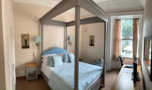 A bed or beds in a room at Broughton Craggs Hotel