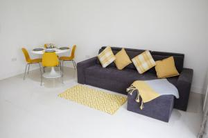 A seating area at sleeps Up To 4 1 Bedsecure Parking