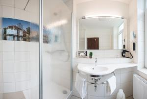 Ein Badezimmer in der Unterkunft Hotel Lindenhof