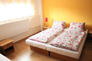 Posteľ alebo postele v izbe v ubytovaní Privát Hriadky