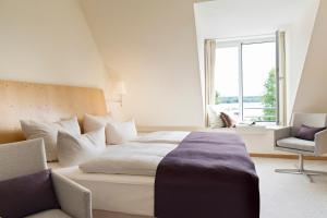 Ein Bett oder Betten in einem Zimmer der Unterkunft Hotel Kleines Meer