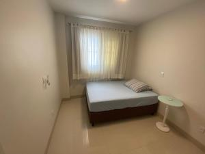 A bed or beds in a room at Residencial Gèneve