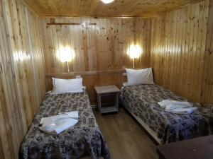 """Кровать или кровати в номере Пансионат """"Аллюр"""""""