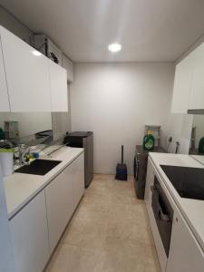 A kitchen or kitchenette at Vortex KLCC Serviced Suites