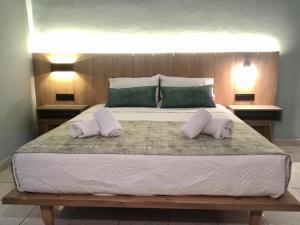 Łóżko lub łóżka w pokoju w obiekcie Poledas Apartments