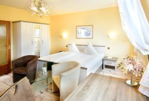 Кровать или кровати в номере Hotel Alexandra