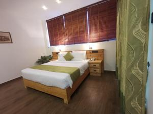 "A bed or beds in a room at HOTEL LAKEFIELD ""Excellence"""