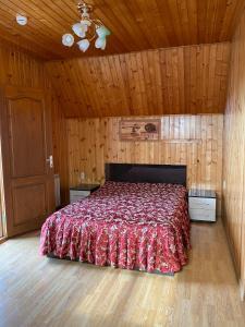Кровать или кровати в номере Малибу
