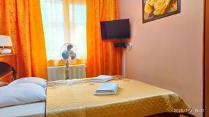 Кровать или кровати в номере Apartment Centralnye