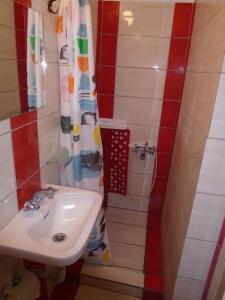 Ένα μπάνιο στο Orfeas Rooms