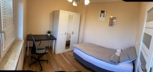 A bed or beds in a room at Apartamenty Starowiejska
