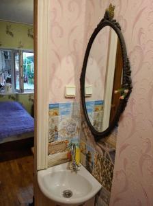 Ванная комната в Guest House on Rybatskiy Poselok 7