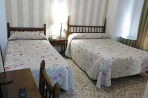 A bed or beds in a room at Andalucía