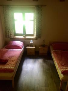 Postel nebo postele na pokoji v ubytování Apartmán Lesková