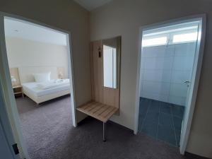 Ein Badezimmer in der Unterkunft Hotel Siebenschläfer am Wasserturm
