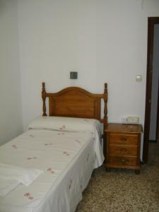 Cama o camas de una habitación en Hostal Residencia Pasaje