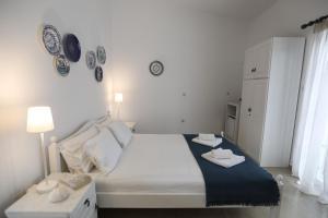 Ένα ή περισσότερα κρεβάτια σε δωμάτιο στο Lykomides