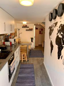 A kitchen or kitchenette at Le Mundi Guesthouse