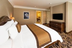 Ein Bett oder Betten in einem Zimmer der Unterkunft Eastin Grand Hotel Saigon