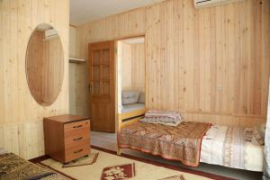 A bed or beds in a room at Bonjour Anapa