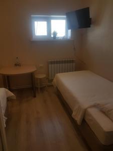 Кровать или кровати в номере Гостиница Ной