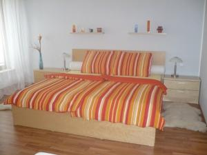 A bed or beds in a room at Apartmán Anežka