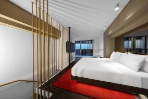 A bed or beds in a room at W Amsterdam