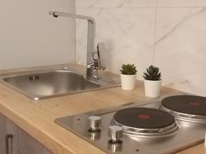 A kitchen or kitchenette at Amazing Apartments @ Monastiraki Subway Station