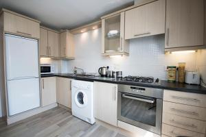 A kitchen or kitchenette at Lochend Serviced Apartments