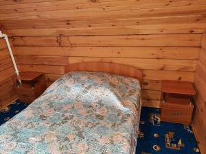 Кровать или кровати в номере Усадьба у Романа
