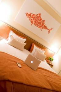 Een bed of bedden in een kamer bij Vista Marina Apartamentos Turisticos