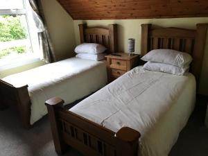 A bed or beds in a room at Campfield House