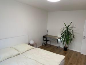 Posteľ alebo postele v izbe v ubytovaní Apartment Nina - city center