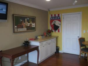 A kitchen or kitchenette at Travel Inn and Suites