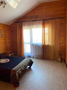 Кровать или кровати в номере Cottage