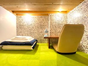 A bed or beds in a room at Guest House MARUYA