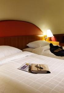 A bed or beds in a room at Ibis Styles Ambassador Seoul Gangnam