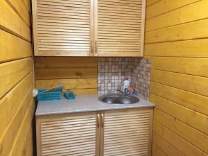 Кухня или мини-кухня в Гостевой дом Сажино