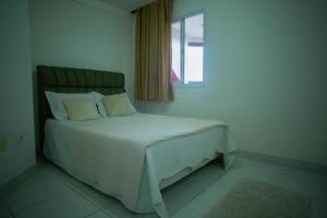 Cama ou camas em um quarto em Apartamento - Praia das Virtudes