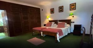 Uma cama ou camas num quarto em Quinta do Prado Verde
