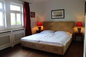 Ein Bett oder Betten in einem Zimmer der Unterkunft Übernachtung in der Vorburg mit Frühstück in der Brückenstraße