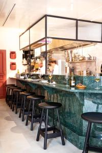A restaurant or other place to eat at Grand Pigalle Hotel