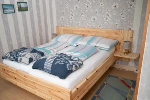 Ein Bett oder Betten in einem Zimmer der Unterkunft Gästehaus Rita Schaefer