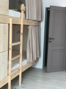 A bunk bed or bunk beds in a room at Hostel D.O.M. Divnomorsk