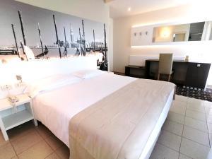 Postel nebo postele na pokoji v ubytování Palace Hotel Regina