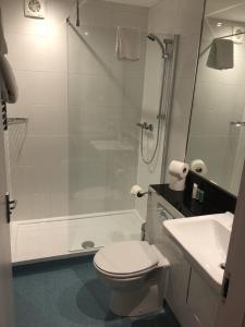 A bathroom at Best Western Lancaster Morecambe Lothersdale Hotel