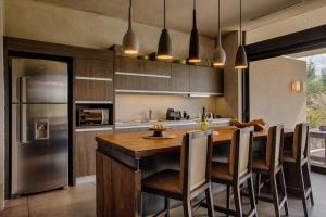 A kitchen or kitchenette at The Vines Resort & Spa