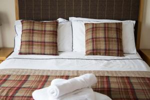 A bed or beds in a room at Ardennan House Hotel